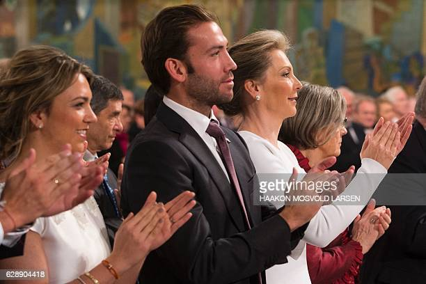 Maria Clemencia Rodriguez wife of Colombian President Juan Manuel Santos and their children Maria Antonia Santos and Martin Santos applaud during the...