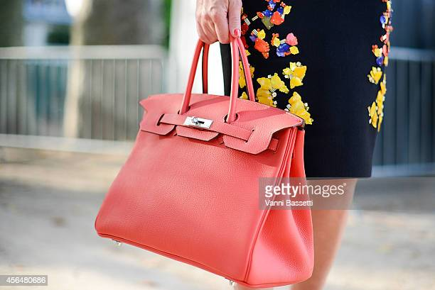 Maria Cleopa poses wearing a Peter Pilotto dress and Hermes bag on the streets of Paris during Paris Fashion week on October 1 2014 in Paris France
