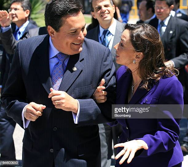 Maria Consuelo Araujo foreign minister of Colombia right speaks with Francisco Lainez foreign minister of Salvador speak before posing for an...