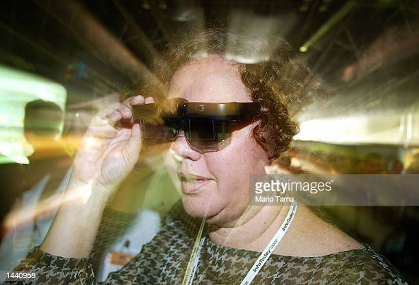 Maria Cristina Arduino tries out a pair of 3D glasses at the unveiling of the X3D system October 1 2002 in New York City X3D software transforms any...