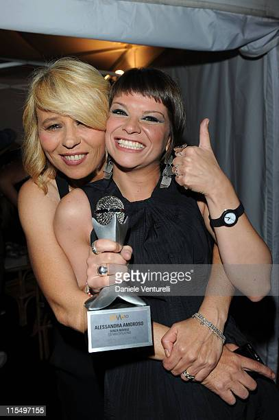 ACCESS *** Maria De Filippi and Alessandra Amoroso attend the Wind Music Awards Backstage at the Arena of Verona on May 29 2010 in Verona Italy