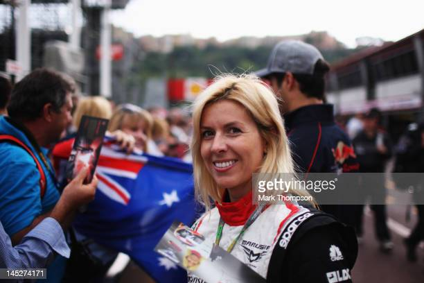 Maria de Villota of Spain and Marussia signs autographs for fans during previews to the Monaco Formula One Grand Prix at the Monte Carlo Circuit on...