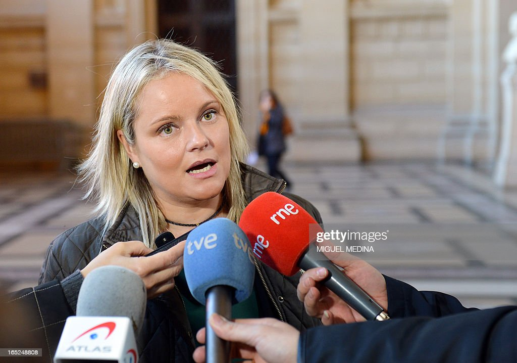 Maria del Mar Blanco, head of the famillies of victims association answers journalists' questions as she arrives at Paris' courthouse to attend the trial of three people thought to be members of the Basque separatist group ETA over the killing of two Spanish civil guards in 2007, on April 2, 2013.