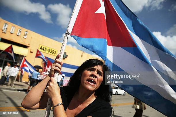 Maria Delgado carries a Cuban flag as she shows her displeasure in the Little Havana neighborhood with the normalization of the Cuban/United States...