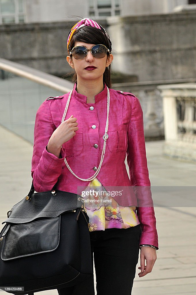 Maria Dimitreva, Fashion Journalist, Harpers Bazaar Bulgaria wears cerise raw pink silk jacket by CNC, silk print Mulberry top, vintage head scarf, Trousers by Dolce & Gabbana, Shoes by Aldo and Italian Black leather bag at London Fashion Week Autumn/Winter 2012 at on February 21, 2012 in London, England.