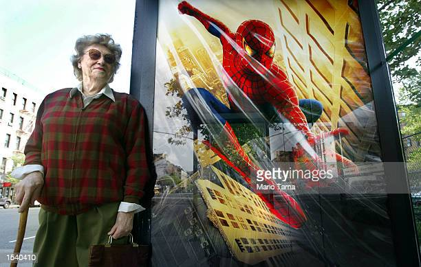 Maria Dobrawsky stands next to 'SpiderMan' advertisement in a bus stop May 7 2002 in New York City 'SpiderMan' the movie shattered records becoming...