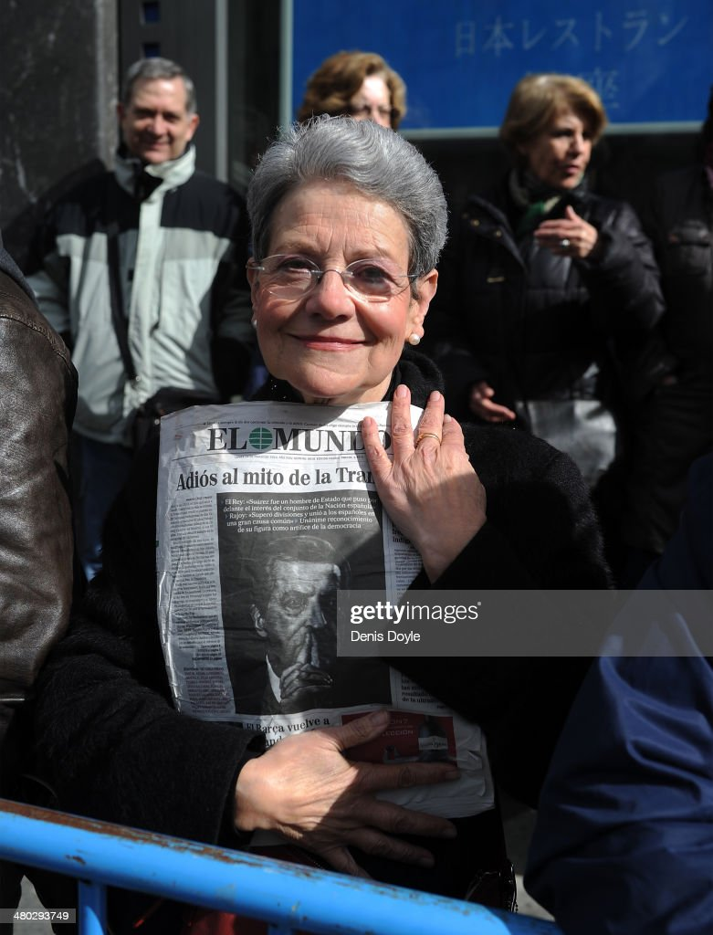 Maria Dolores Carmona holds a copy of El Mundo newspaper showing a photograph of former Prime Minister Adolfo Suarez outside Spanish parliament on March 24, 2014 in Madrid, Spain. Suarez, who died on March 23 in Madrid, was the first democratically elected Spanish prime minister after the death of dictator General Francisco Franco.