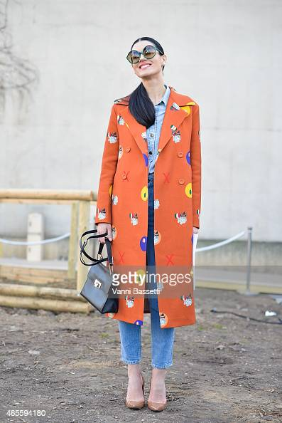 Maria Efrosinina poses wearing a Poustovit coat on Day 6 of Paris Fashion Week Womenswear FW15 on March 8 2015 in Paris France