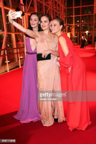 Maria Ehrich Emilia Schuele and Sonja Gerhardt take a selfie during the Goldene Kamera reception at Messe Hamburg on March 4 2017 in Hamburg Germany