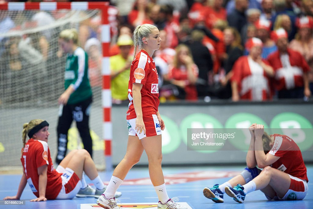 Maria Fisker of Denmark, Goalkeeper Rikke Poulsen of Denmark, Trine Ostergaard of Denmark and Line Jorgensen of Denmark looks dejected after the 22nd IHF Women's Handball World Championship Quarter Final match between Denmark and Romania in Jyske Bank Boxen on December 16, 2015 in Herning, Denmark.