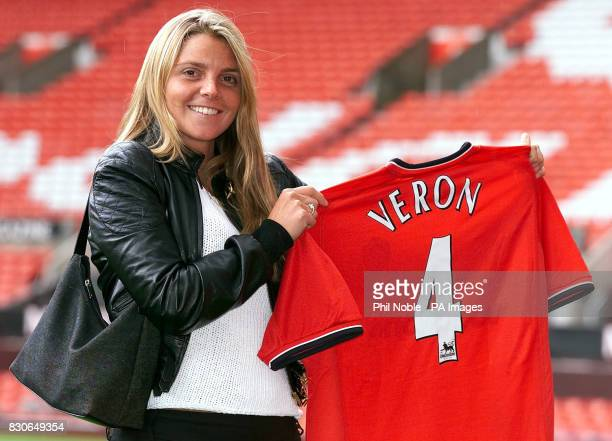 LEAGUE Maria Florencia girlfriend of Manchester United's new signing Juan Sebastian Veron holds his shirt at Old Trafford Manchester Veron completed...