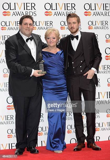 Maria Freedman and David Babani with their Best Musical Revival award for Merrily We Roll Along with award presenter Arthur Darvill during the...