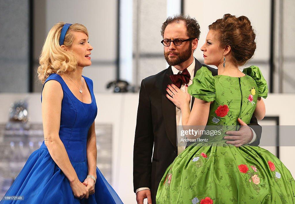 Maria Furtwaengler, Nikolaus Szentmiklosi and Alessija Lause perform during the 'Geruechte...Geruechte...' photo rehearsal at Komoedie am Kurfuerstendamm Theater on January 9, 2013 in Berlin, Germany.