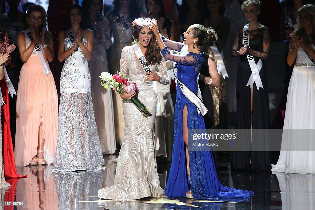 Maria Gabriela Isler, Miss Universe 2013, is crowned by <a gi-track='captionPersonalityLinkClicked' href=/galleries/search?phrase=Olivia+Culpo&family=editorial&specificpeople=9194131 ng-click='$event.stopPropagation()'>Olivia Culpo</a> at Miss Universe Pageant 2013 on November 9, 2013 in Moscow, Russia.