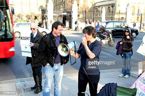 Maria Gallestegui eminent Parliament Square peace campaigner and Mark Thomas comedian and reporter in Parliament Square on a Mass Lone Demos...