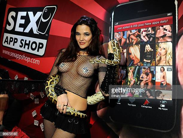 Maria Gara a magician and snake handler known as SnakeBabe poses with a python at the Sex App Shop booth at the 2010 AVN Adult Entertainment Expo at...