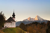 Maria Gern Church and Watzmann massif in the background.  Early morning Landscape in Bavarian Alps, Germany.