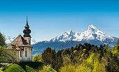 Germany Bavaria Berchtesgaden, Maria Gern Church (pilgrimage church) in front of the Watzmann Mountain. The Watzmann is with 2713 meter the highest Mountain in the Berchtesgadener Land.