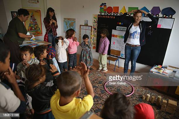 Maria Gheorghiu cofounder of the Romanian NGO OvidiuRo teaches young Roma children parts of the body in the preschool class in the abjectly poor Roma...