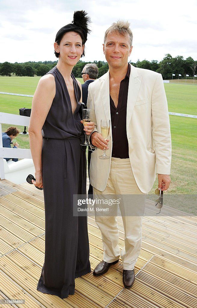 Maria Grachvogel (L) and Mike Simcock attend day 2 of the Audi Polo Challenge at Coworth Park Polo Club on August 4, 2013 in Ascot, England.
