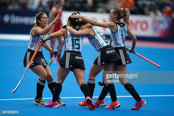 Maria Granatto of Argentina is congratulated by teammates after scoring the game's opening goal during the FIH Women's Hockey Champions Trophy 2016...