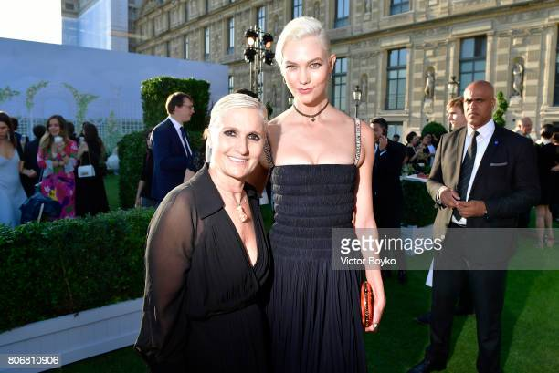 Maria Grazia Chiuri and Karlie Kloss attend 'Christian Dior couturier du reve' Exhibition Launch celebrating 70 years of creation at Loulou Club on...