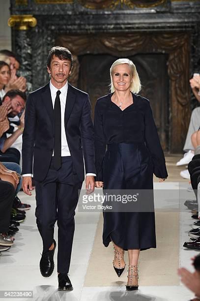 Maria Grazia Chiuri and Pierpaolo Piccioli walk the runway during the Valentino Menswear Spring/Summer 2017 show as part of Paris Fashion Week on...