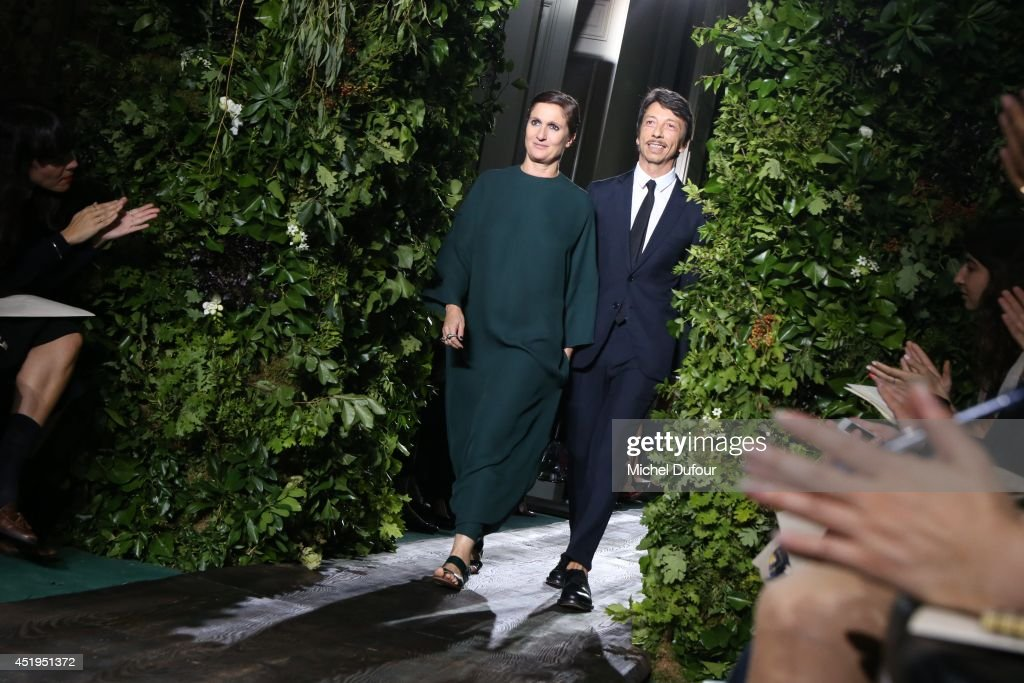 <a gi-track='captionPersonalityLinkClicked' href=/galleries/search?phrase=Maria+Grazia+Chiuri&family=editorial&specificpeople=5551257 ng-click='$event.stopPropagation()'>Maria Grazia Chiuri</a> and Pirpaolo Picciolini walk the runway during the Valentino show as part of Paris Fashion Week - Haute Couture Fall/Winter 2014-2015 at Hotel Salomon de Rothschild on July 9, 2014 in Paris, France.