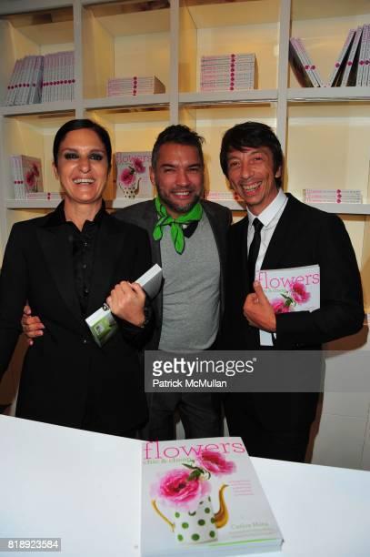 Maria Grazia Chiuri Carlos Mota and Pier Paolo Piccioli attend VALENTINO hosts Carlos Mota book launch 'Flowers Chic and Cheap' at Valentino on May 4...