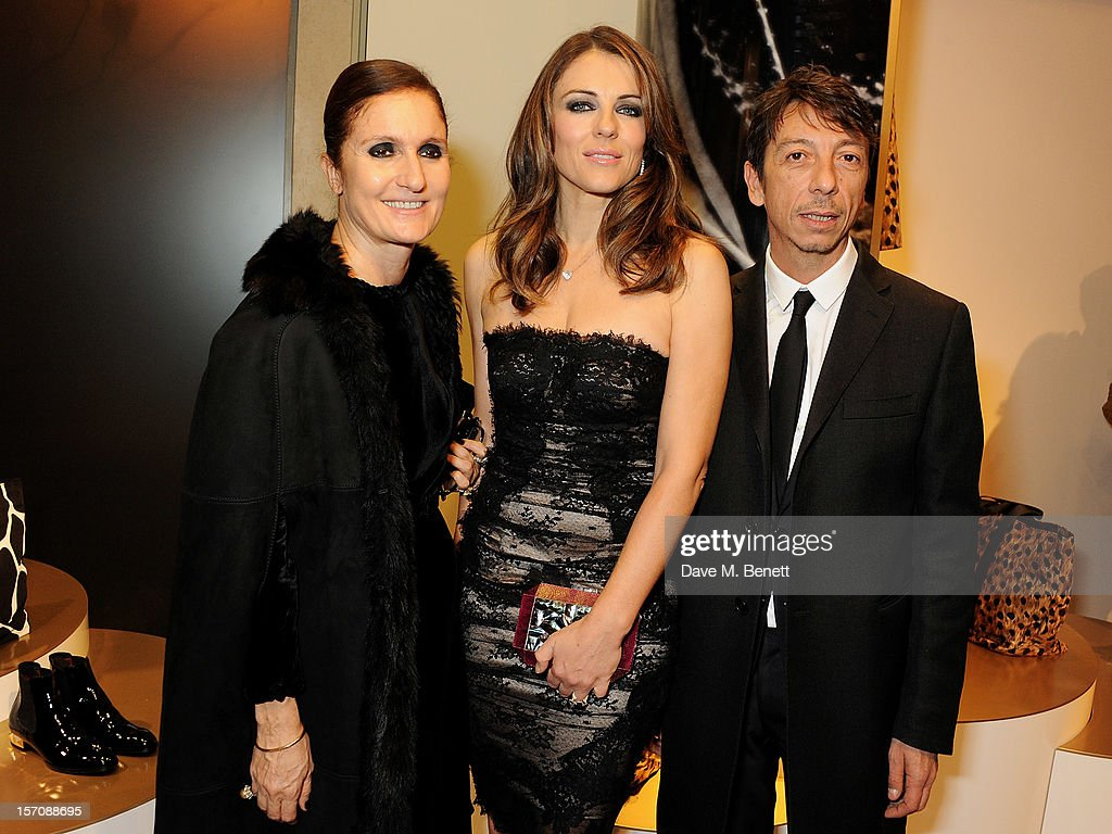 Maria Grazia Chiuri, Elizabeth Hurley and Pier Paolo Piccioli attend a private view of 'Valentino: Master Of Couture', exhibiting from November 29th, 2012 - March 3, 2013, at Somerset House on November 28, 2012 in London, England.