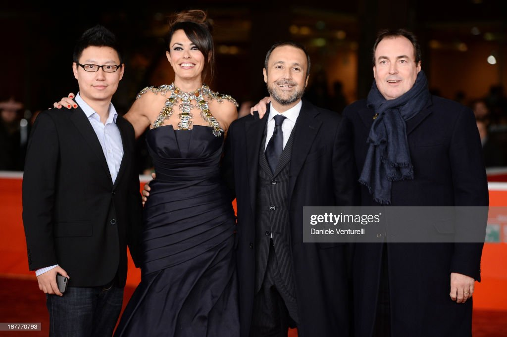 <a gi-track='captionPersonalityLinkClicked' href=/galleries/search?phrase=Maria+Grazia+Cucinotta&family=editorial&specificpeople=236018 ng-click='$event.stopPropagation()'>Maria Grazia Cucinotta</a> (2ndL), Giulio Violati (R) and guest attend 'Out Of The Furnace' Premiere during The 8th Rome Film Festival on November 12, 2013 in Rome, Italy.