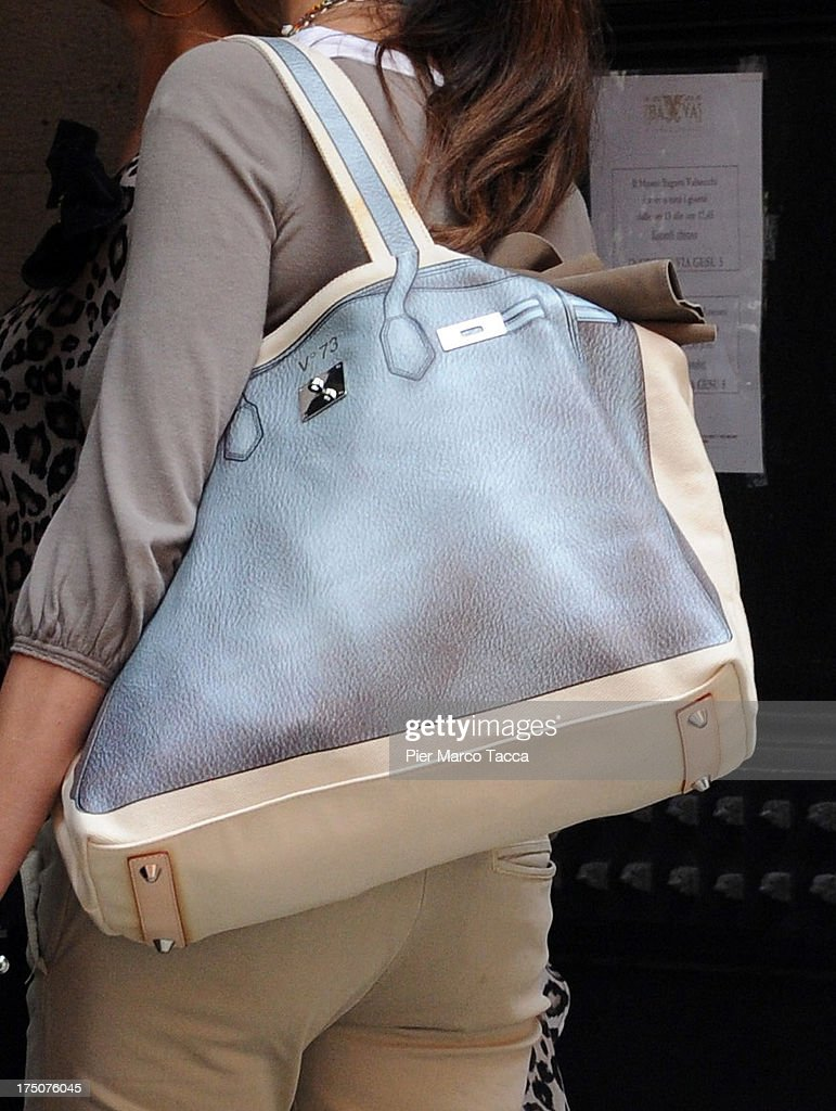<a gi-track='captionPersonalityLinkClicked' href=/galleries/search?phrase=Maria+Grazia+Cucinotta&family=editorial&specificpeople=236018 ng-click='$event.stopPropagation()'>Maria Grazia Cucinotta</a> (bag detail) is sighted in via Montenapoleone on July 29, 2013 in Milan, Italy.