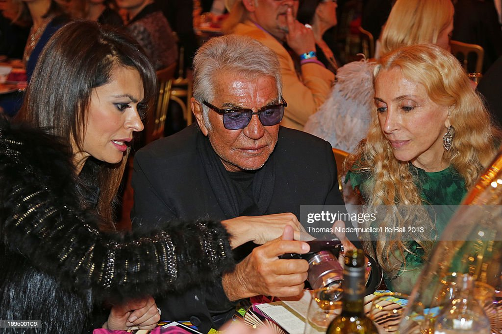 Maria Grazia Cucinotta, Roberto Cavalli and Franca Sozzani attend the 'AIDS Solidarity Gala 2013' at Hofburg Vienna on May 25, 2013 in Vienna, Austria.