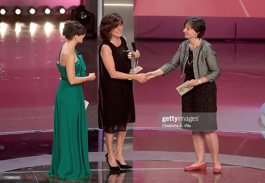 Maria Grazia Roncarolo (C) receives Bellisario award from Minister of Education Maria Chiara Carrozza (R) during the Premio Bellisario 2013 at Dear RAI studios on June 20, 2013 in Rome, Italy.