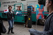 Maria Guerrero an HIV Prevention Specialist with Community Healthcare Network solicits people on the street to take a free HIV test in a mobile...
