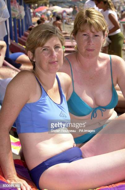 Maria Haines 31 and Julie Harris 32 from Billericay in Essex on the beach at Benalmadena on the Costa Del Sol in Spain despite a series of bomb...