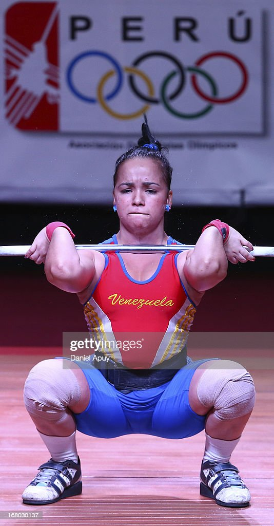 Maria Herrera of Venezuela B competes in the Women's 48kg during day one of the 2013 Junior Weightlifting World Championship at Maria Angola Convention Center on April 04, 2013 in Lima, Peru.