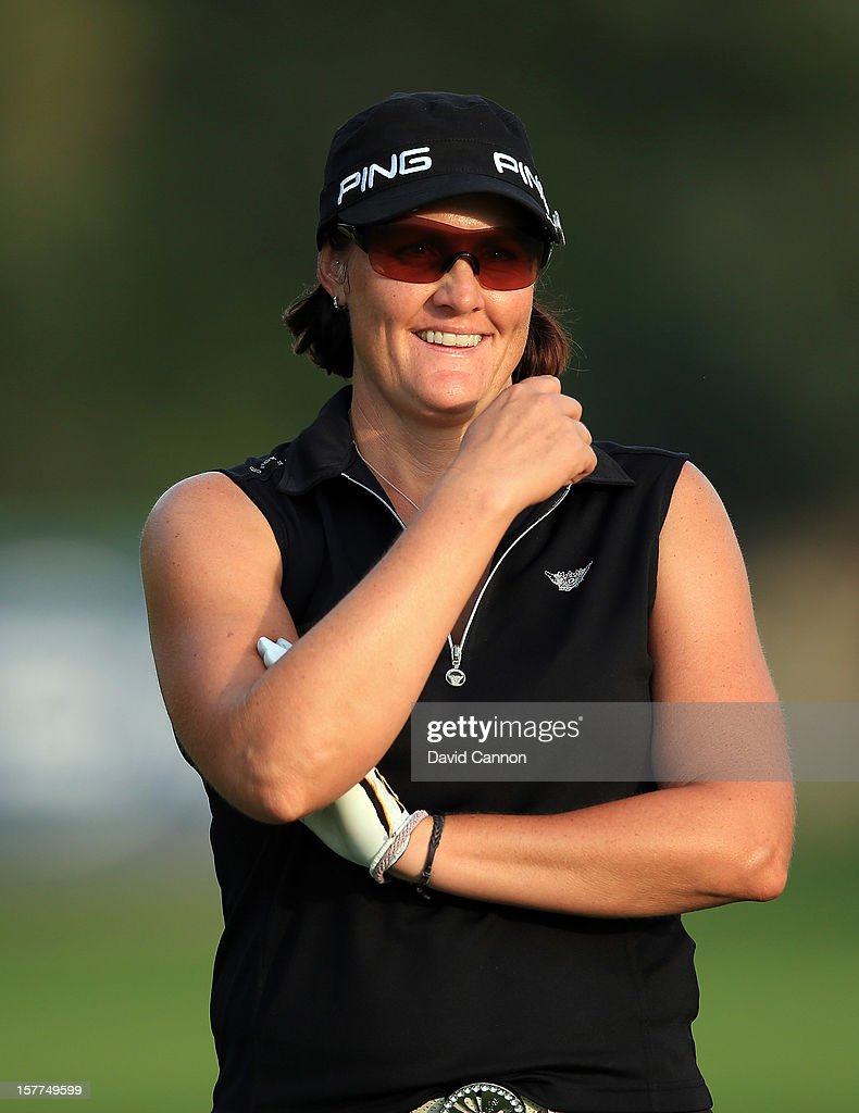 Maria Hjorth of Sweden waiting to play her second shot at the par 5, 18th hole during the second round of the 2012 Omega Dubai Ladies Masters on the Majilis Course at the Emirates Golf Club on December 6, 2012 in Dubai, United Arab Emirates.