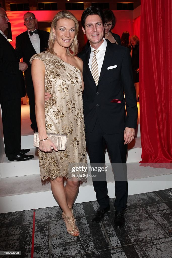 Maria Hoefl-Riesch and her husband Marcus Hoefl arrive at the Ein Herz fuer Kinder Gala 2014 at Tempelhof Airport on December 6, 2014 in Berlin, Germany.