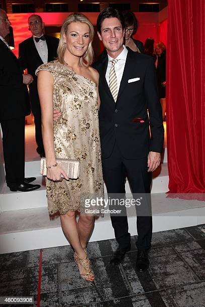 Maria HoeflRiesch and her husband Marcus Hoefl arrive at the Ein Herz fuer Kinder Gala 2014 at Tempelhof Airport on December 6 2014 in Berlin Germany