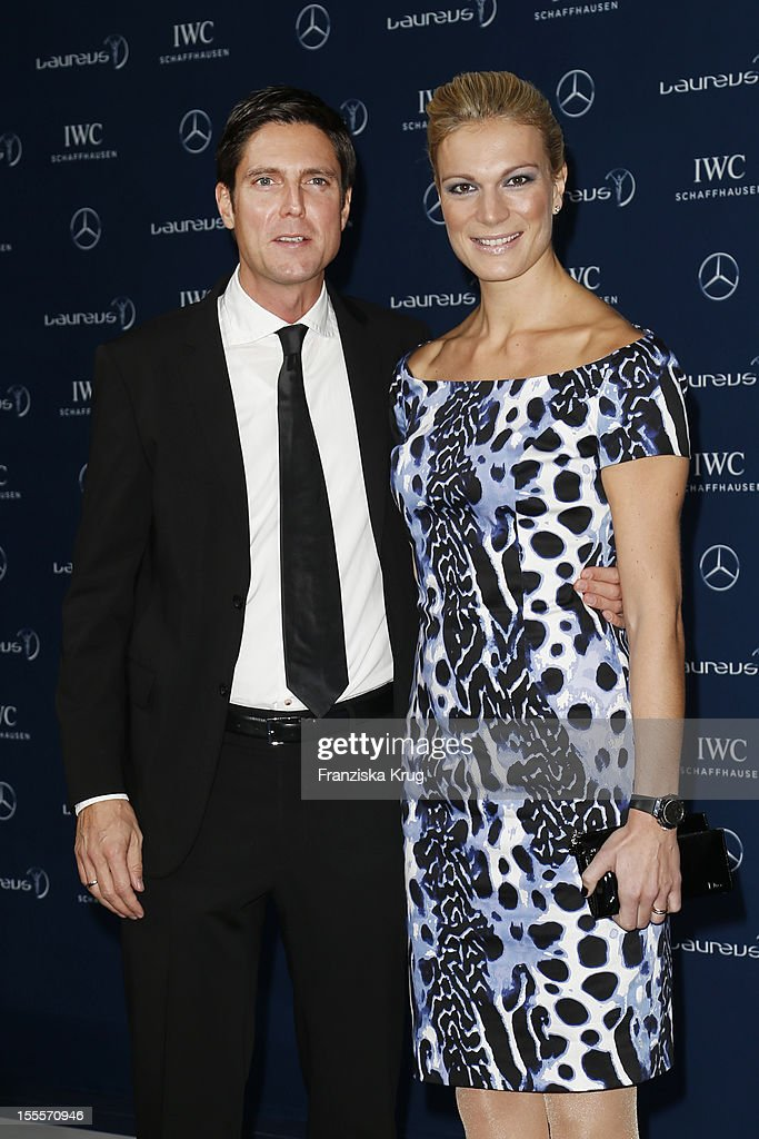 <a gi-track='captionPersonalityLinkClicked' href=/galleries/search?phrase=Maria+Hoefl-Riesch&family=editorial&specificpeople=7648886 ng-click='$event.stopPropagation()'>Maria Hoefl-Riesch</a> and her husband <a gi-track='captionPersonalityLinkClicked' href=/galleries/search?phrase=Marcus+Hoefl&family=editorial&specificpeople=6890458 ng-click='$event.stopPropagation()'>Marcus Hoefl</a> attend the Laureus Media Award 2012 on November 05, 2012 in Kitzbuehel, Austria.