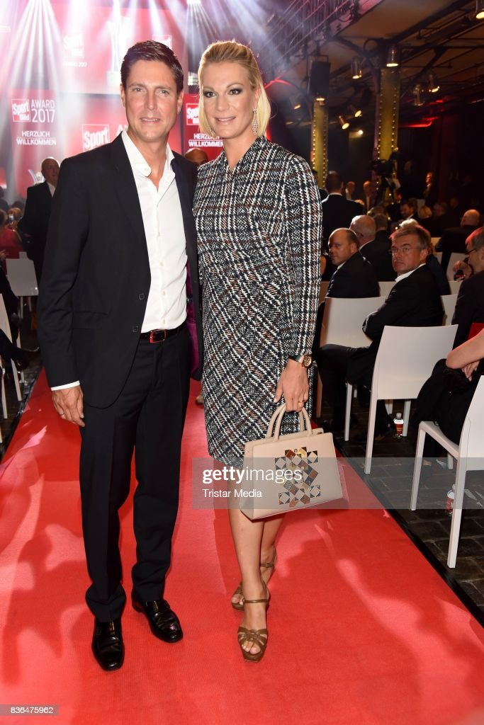 Maria Hoefl-Riesch and her husband Marcus Hoefl attend the Sport Bild Award on August 21, 2017 in Hamburg, Germany.