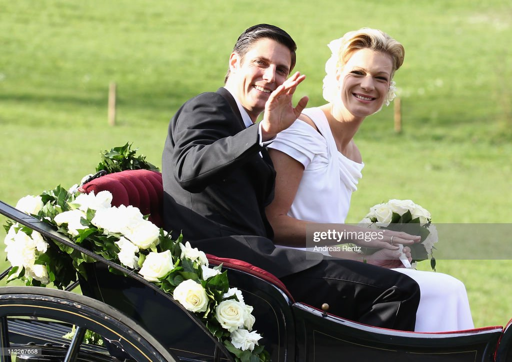 Maria Hoefl-Riesch and her husband Marcus Hoefl smile after their church wedding at the Pfarrkirche on April 16, 2011 in Going am Wilden Kaiser, Austria.