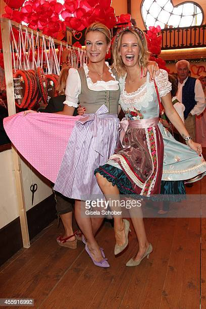 Maria HoeflRiesch and Monica Ivancan attend the 'Sixt Damen Wiesn' at Marstall tent during Oktoberfest at Theresienwiese on September 22 2014 in...
