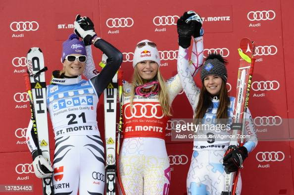 Maria HoeflRiesch Lindsey Vonn Tina Weirather on the podium during the Audi FIS Alpine Ski World Cup Women's Downhill on January 28 2012 in StMoritz...