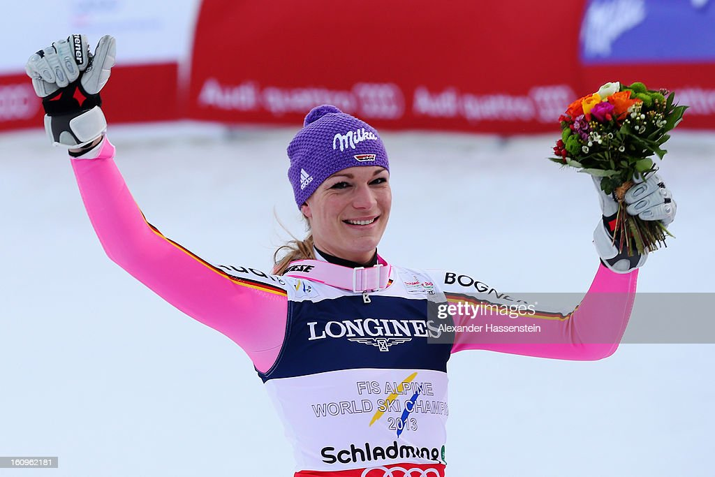 <a gi-track='captionPersonalityLinkClicked' href=/galleries/search?phrase=Maria+Hoefl-Riesch&family=editorial&specificpeople=7648886 ng-click='$event.stopPropagation()'>Maria Hoefl-Riesch</a> of Germany celebrates at the flower ceremony after winning the Women's Super Combined during the Alpine FIS Ski World Championships on February 8, 2013 in Schladming, Austria.