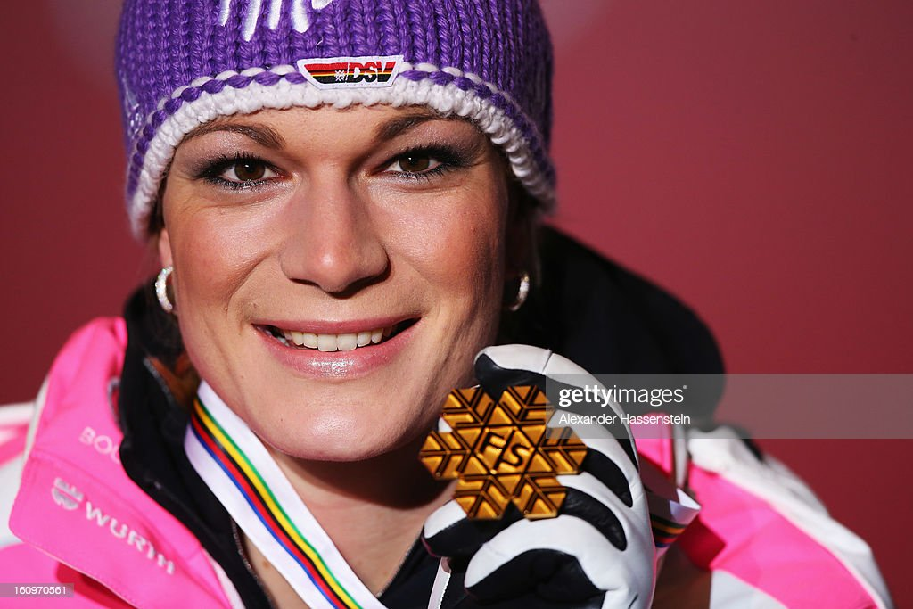 Maria Hoefl-Riesch of Germany celebrates at the medal ceremony with her gold medal after winning the Women's Super Combined during the Alpine FIS Ski World Championships on February 8, 2013 in Schladming, Austria.