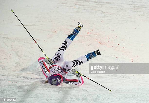 Maria HoeflRiesch of Germany falls while skiing in the Men and Women's Nations Team Event during the Alpine FIS Ski World Championships on February...