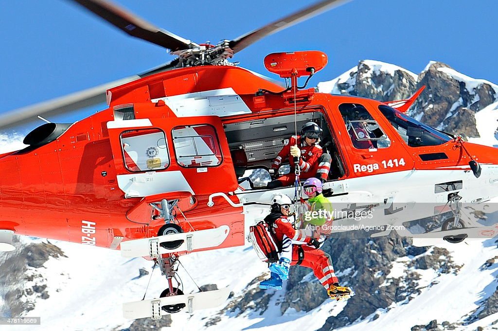 Maria Hoefl-Riesch of Germany is helicoptered off the piste having crashed during the Audi FIS Alpine Ski World Cup Finals Women's Downhill on March 12, 2014 in Lenzerheide, Switzerland. (Photo by Alain Grosclaude/Agence Zoom/Getty Images)2