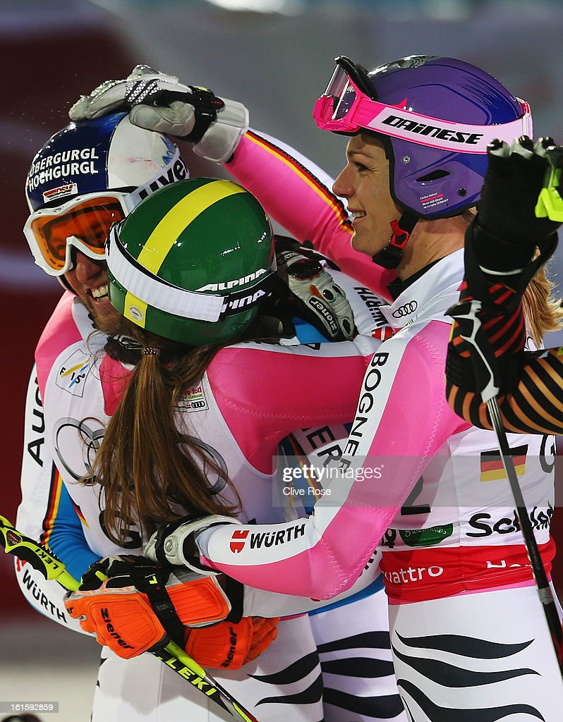 <a gi-track='captionPersonalityLinkClicked' href=/galleries/search?phrase=Maria+Hoefl-Riesch&family=editorial&specificpeople=7648886 ng-click='$event.stopPropagation()'>Maria Hoefl-Riesch</a> of Germany reacts with team mates <a gi-track='captionPersonalityLinkClicked' href=/galleries/search?phrase=Lena+Duerr&family=editorial&specificpeople=6479654 ng-click='$event.stopPropagation()'>Lena Duerr</a> (C), and Fritz Dopfer (L) in the finish area in the Men and Women's Nations Team Event during the Alpine FIS Ski World Championships on February 12, 2013 in Schladming, Austria.